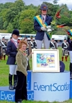 Presenting the painting for the winning owner to Sabrina Mertens, the individual Gold Medal rider from Germany, at the European Young Rider Eventing Championships, Blair Castle, August 2007